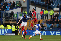 Kyle Bartley of Swansea City heads the ball away from Atdhe Nuhiu of Sheffield Wednesday during The Emirates FA Cup Fifth Round match between Sheffield Wednesday and Swansea City at Hillsborough, Sheffield, England, UK. Saturday 17 February 2018