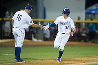 Chris DeVito (34) of the Burlington Royals shakes hands with third base coach Scott Thorman (16) after hitting a home run against the Princeton Rays at Burlington Athletic Stadium on June 24, 2016 in Burlington, North Carolina.  The Rays defeated the Royals 16-2.  (Brian Westerholt/Four Seam Images)