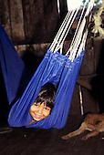 Amapa State, Brazil. Smiling caboclo child in a blue hammock.