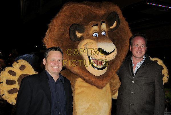 """ERIC DARNELL & TOM McGRATH.The """"Madagascar Escape 2 Africa"""" - UK Premiere - Outside Arrivals at Empire Leicester Square, London, England. November 23rd 2008.half length black jacket coat lion dress-up costume leather black brown directors .CAP/CAN.©Can Nguyen/Capital Pictures."""