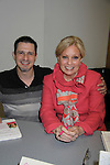 """Damon Jacobs of We Love Soaps poses with Guiding Light's Tina Sloan """"Liillian Raines"""" as she discusses and signs her new book """"Changing Shoes"""" at Mid-Manhattan Library, New York City, New York on November 10, 2010. (Photo by Sue Coflin/Max Photos)"""