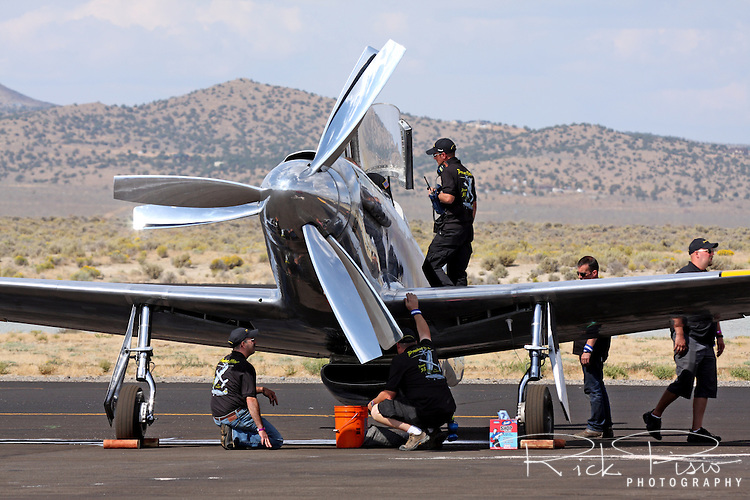 Ground crew member inspect the P-51 Mustang Precious Metal after a race during the 2011 National Championship Air Races