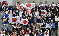 Wolfsburg , 100711 , FIFA / Frauen Weltmeisterschaft 2011 / Womens Worldcup 2011 , Viertelfinale ,  Deutschland (GER) - Japan (JPN) .japanische Fans jubeln auf der Tribüne nach dem Siegtreffer zum 1:0 .Foto:Karina Hessland .