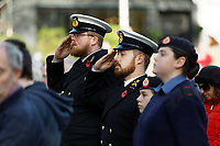 Pictured: Two members of the armed forces observe two minutes silence at Castle Square Gardens in Swansea, Wales, UK. Monday 11 November 2019<br /> Re: Armistice Day, a service to commemorate those who lost their lives in conflict has been held at Castle Square Gardens in Swansea, Wales, UK.