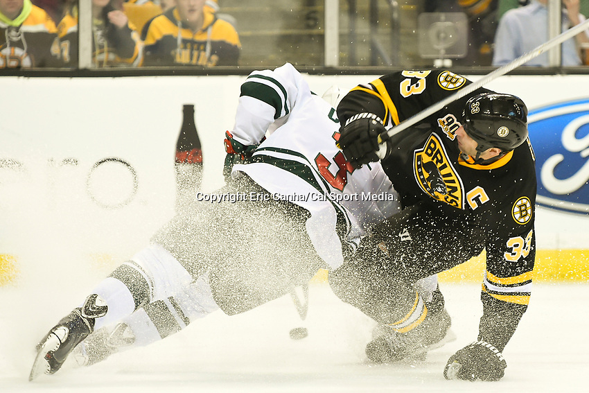 March 17, 2014 - Boston, Massachusetts , U.S. - Boston Bruins defenseman Zdeno Chara (33) crashes into Minnesota Wild center Charlie Coyle (3) during the NHL game between the Minnesota Wild and the Boston Bruins held at TD Garden in Boston Massachusetts. The Bruins defeated the Wild 4-1 at the end of regulation.  Eric Canha/CSM