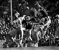 Oakland Raiders defense puts a rush on San Diego Charger QB Dan Fouts...#76  Mike McCoy amd #72 John Matuszak..(1978 photo/Ron Riesterer)