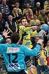 Rhein Neckar Loewe Bogdan Radivojevic (Nr.14)  gegen G&ouml;ppingens Daniel Rebmann (Nr.12) beim Spiel in der Handball Bundesliga, Rhein Neckar Loewen - FRISCH AUF! Goeppingen.<br /> <br /> Foto &copy; PIX-Sportfotos *** Foto ist honorarpflichtig! *** Auf Anfrage in hoeherer Qualitaet/Aufloesung. Belegexemplar erbeten. Veroeffentlichung ausschliesslich fuer journalistisch-publizistische Zwecke. For editorial use only.