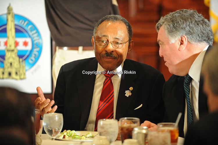 Senator Roland Burris sits at Maggiano's restaurant beside City Club of Chicago president Jay Doherty during a City Club luncheon in Chicago, Illinois on February 18, 2009.  Burris admitted in Peoria, Illinois on February 16 to trying unsuccessfully to raise campaign funds for impeached former Illinois Governor Rod Blagojevich while seeking a Senate appointment.