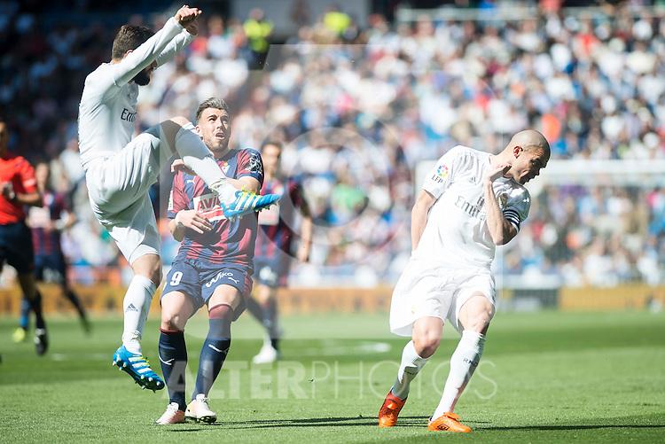 Real Madrid's Nacho and Pepe and Sociedad Deportiva Eibar's Antonio Luna during La Liga match. April 09, 2016. (ALTERPHOTOS/Borja B.Hojas)