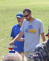 Fatima coach Marcus Bridges (left) had a good day as his Fatima Comets captured the 1A-2A Varsity Boys and Girls race titles.