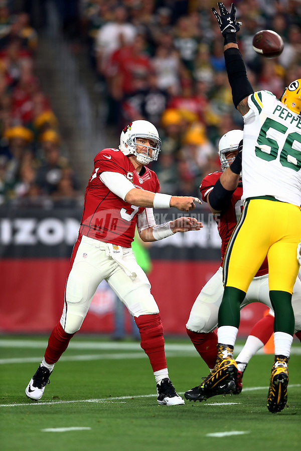 Dec 27, 2015; Glendale, AZ, USA; Arizona Cardinals quarterback Carson Palmer throws a pass in the first half against the Green Bay Packers at University of Phoenix Stadium. The Cardinals defeated the Packers 38-8. Mandatory Credit: Mark J. Rebilas-USA TODAY Sports