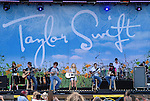 Photo by Mike Ullery.Taylor Swift and her band perform at Country Concert in the Hills at Hickory Hills Lake near Ft. Loramie, Ohio on Sunday, July 13, 2008.