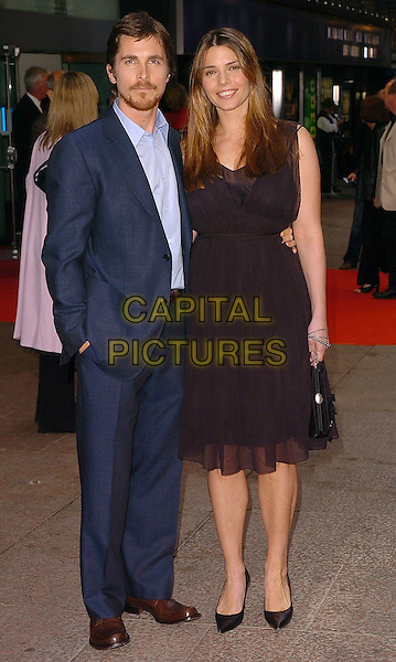 "CHRISTIAN BALE & SIBI BLAZIC.Attend the Uk Premiere of ""Batman Begins"",.Odeon Cinema Leicester Square..London, June 12th 2005..full length couple.Ref: CAN.www.capitalpictures.com.sales@capitalpictures.com.©Can Nguyen/Capital Pictures"