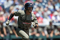 Vanderbilt Commodores third baseman Austin Martin (16) runs to first base during Game 3 of the NCAA College World Series against the Louisville Cardinals on June 16, 2019 at TD Ameritrade Park in Omaha, Nebraska. Vanderbilt defeated Louisville 3-1. (Andrew Woolley/Four Seam Images)