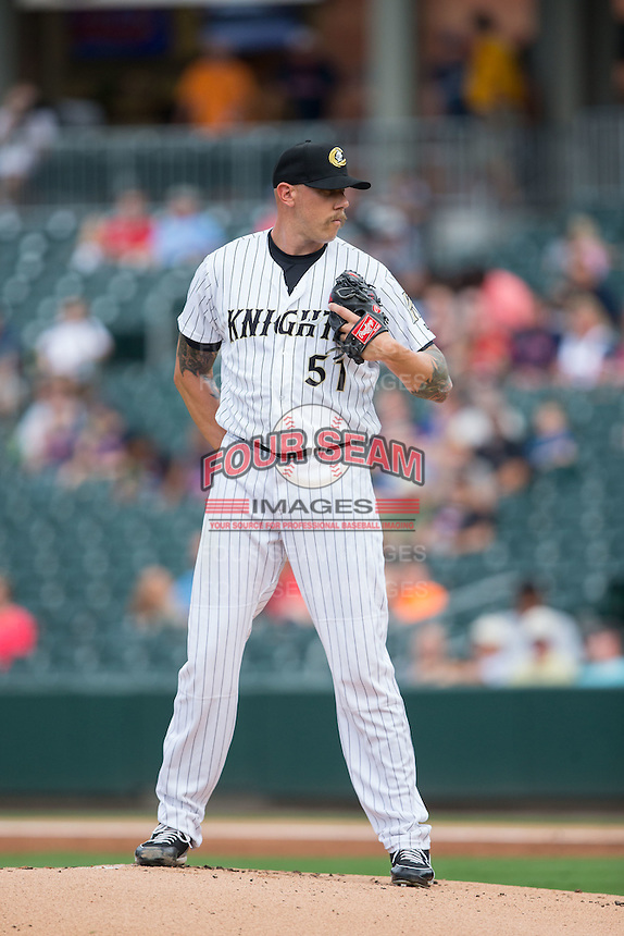 Charlotte Knights starting pitcher Kameron Loe (51) looks to his catcher for the sign against the Pawtucket Red Sox at BB&T BallPark on July 6, 2016 in Charlotte, North Carolina.  The Knights defeated the Red Sox 8-6.  (Brian Westerholt/Four Seam Images)