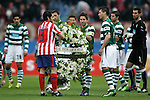 Atletico de Madrid's Antonio Lopez receives a flower crown given by Sporting de Portugal's Joao Moutinho and Anderson Polga in memoriam of the victims of the march 11 2004 attacks in Madrid before UEFA Europa League match. March 11, 2010. (ALTERPHOTOS/Alvaro Hernandez)