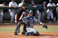 Xavier Musketeers catcher Nate Soria (5) throws the ball back to his pitcher during the game against the Penn State Nittany Lions at Coleman Field at the USA Baseball National Training Center on February 25, 2017 in Cary, North Carolina. The Musketeers defeated the Nittany Lions 10-4 in game one of a double header. (Brian Westerholt/Four Seam Images)