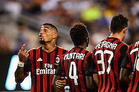 A. C. Milan midfielder Kevin-Prince Boateng (10) helps set up a wall with midfielder Sulley Muntari (4), Andrea Petagna (37) , and Mbaye Niang (78) . Chelsea F. C. defeated A. C. Milan 2-0 during round two of the 2013 Guinness International Champions Cup at MetLife Stadium in East Rutherford, NJ, on August 04, 2013.