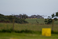 "Wednesday 14 June 2017<br /> Pictured: Tanks on the Castlemartin Range  <br /> Re: Paramedics and a fire crews are in attendance at what has been describes as an ""ongoing incident"" at a military training base in Pembrokeshire.<br /> The Welsh Ambulance Service said it was alerted to an incident at the Castlemartin firing range just before 15:30 BST on Wednesday.<br /> The range is owned by the Ministry of Defence (MOD) Live firing was due to take place at the range from Monday to Friday.<br /> Mid and West Wales Fire and Rescue Service is also in attendance.<br /> Castlemartin is the only UK Army range normally available for direct-fire live gunnery exercises and is used by Army, Army reserves and cadets.<br /> It is also used by civilian organisations and research establishments."