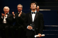 PICTURE BY VAUGHN RIDLEY/SWPIX.COM - Leeds International Piano Competition 2012 - Leeds Town Hall, Leeds, England - 15/09/12 - Jiayan Sun of China with the 3rd place Award.