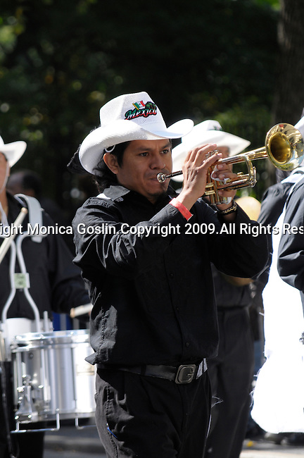 The Hispanic Parade in New York City. A man representing Mexico and playing the trumpet in the Hispanic Parade in New York City.