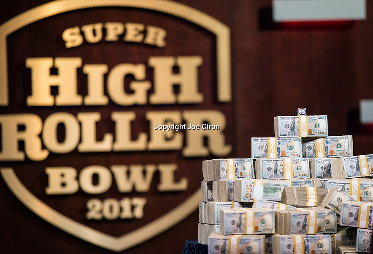Winner's Ring Atop Cash Pile