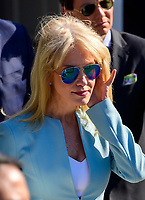 Senior Counselor Kellyanne Conway listens as United States President Donald J. Trump makes remarks and answers questions from the media as he departs the South Lawn of the White House in Washington, DC for a day of activities in San Antonio, Texas and Houston, Texas on April 10, 2019.<br /> CAP/MPI/RS<br /> &copy;RS/MPI/Capital Pictures