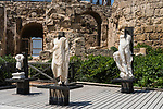 Roman and Byzantine statues by the theater at Caesarea Maritima in Caesarea National Park in Israel.  The city was built as a port on the Mediterranean Sea by Herod the Great between 22 and 15 B.C.  The small Byzantine statue at left represents Christ, the Good Shepard.