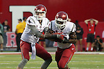 Luke Falk, Washington State University quarterback, hands off to running back Gerard Wicks during the Cougars first road test of the season against Big Ten foe Rutgers at High Point Solutions Stadium in Piscataway, New Jersey, on September 12, 2015.  WSU came back from a late deficit to go on a 90 yard touchdown drive to score the winning TD with 13 seconds left to get the win, 37-34.