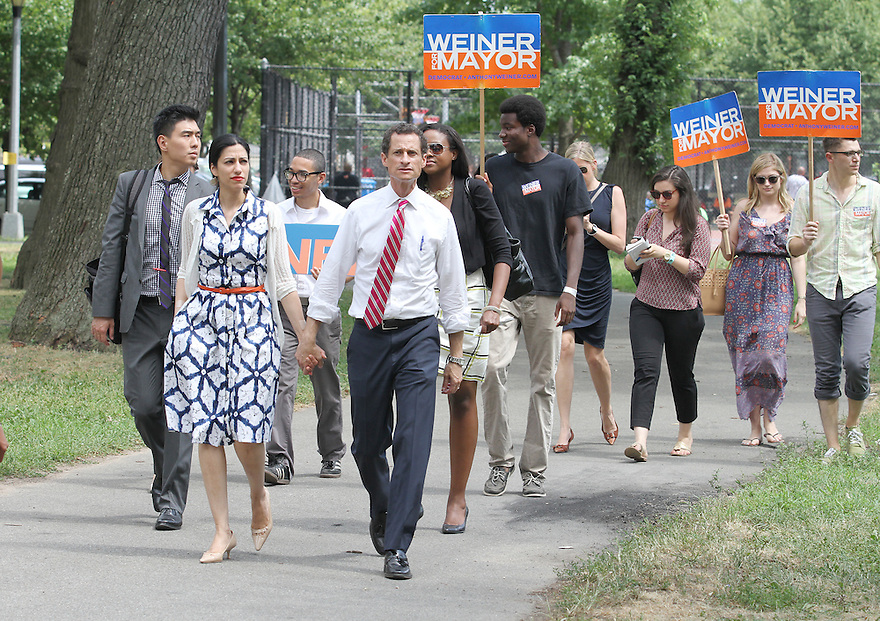 Anthony Weiner right, along with wife Huma Abedin attend the Jamaica Jerk Festival at Roy Wilkins Park in Queens on Sunday, July 21, 2013. (AP Photo/ Donald Traill)