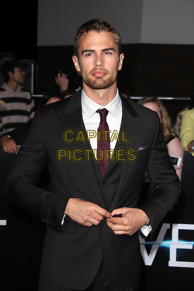 WESTWOOD, CA - March 18: Theo James at the &quot;Divergent&quot; Los Angeles Premiere, Regency Bruin Theatre, Westwood,  March 18, 2014. <br /> CAP/MPI/JO<br /> &copy;Janice Ogata/MediaPunch/Capital Pictures