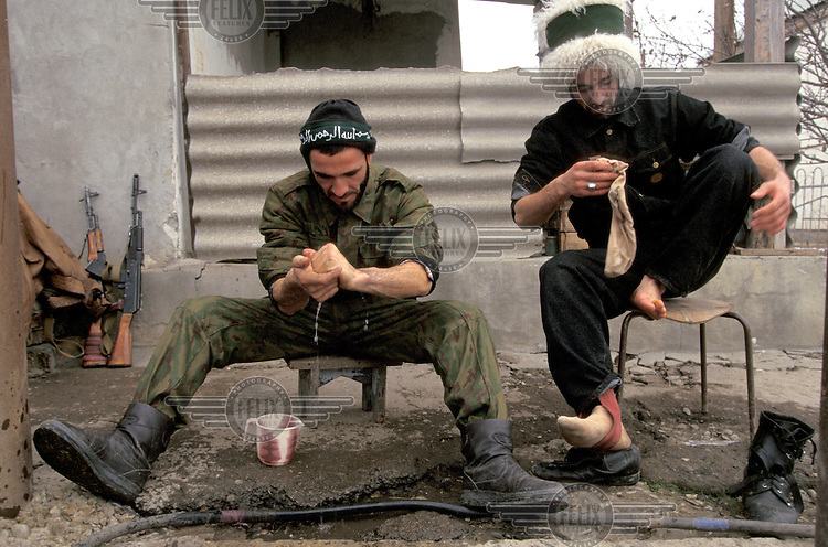 Chechen soldiers wash themselves before prayers prior to going into battle. In December 1994 Russian troops entered Chechnya in an attempt to quash the countryÕs independence movement.  Early promises of a quick victory were soon silenced as the Chechens put up fierce resistance to the Russian assault and the death toll mounted.  Up to 100,000 people Ð many of them civilians Ð are estimated to have been killed in the 20 month war that followed.