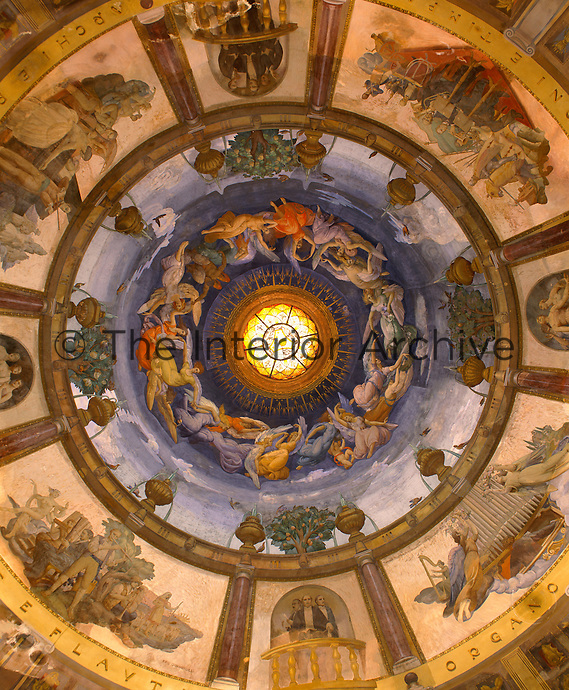 The ornate trompe l'oeil domed ceiling by Ezio Giovannozzi at the Tettuccio spa at Montecatini has angels circling the coloured glass ceiling lantern in the centre
