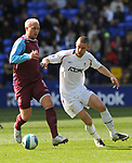Dean Ashton of West Ham United and Gary Cahill of Bolton Wanderers during the Premier League match at the Reebok Stadium, Bolton. Picture date 12th April 2008. Picture credit should read: Simon Bellis/Sportimage