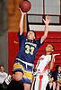 Brittny Membreno #33 of Massapequa, left, draws a shooting foul during a Nassau County AA-1 varsity girls basketball game against host Freeport High School on Friday, Dec. 22, 2017. Massapequa won by a score of 43-39.