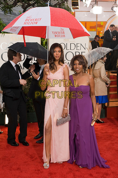 MAVIS SPENCER, Miss Golden Globe 2010 & ALFRE WOODARD.Arrivals at the 67th Golden Globe Awards held Beverly Hilton, Beverly Hills, California, USA..January 17th, 2010.globes full length pink dress wrap bows slit split clutch bag purple one shoulder umbrella .CAP/AW/HFPA.Supplied by Anita Weber/Capital Pictures