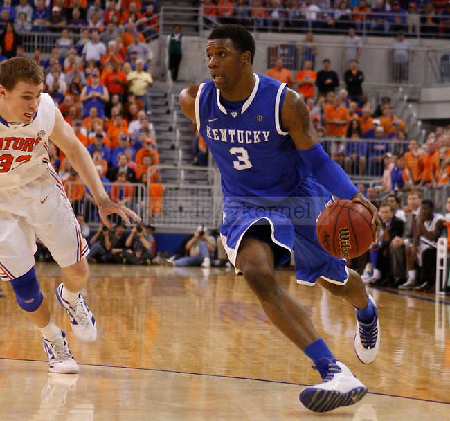 UK forward Terrence Jones drives past Florida's Erik Murphy during the second half of the University of Kentucky's men basketball game against University of Florida 3/4/12 at the O'Connell Center in Gainesville, Fl. Photo by Quianna Lige | Staff