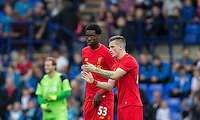 Ryan Kent of Liverpool talks tactics with Ovie Ejaria of Liverpool during the 2016/17 Pre Season Friendly match between Tranmere Rovers and Liverpool at Prenton Park, Birkenhead, England on 8 July 2016. Photo by PRiME Media Images.