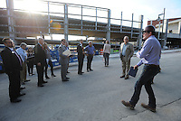 NWA Democrat-Gazette/ANDY SHUPE<br /> David Swain (right), owner representative for the Walton Arts Center, speaks Tuesday, Sept. 22, 2015, during a tour of the new administrative offices being constructed as part of Fayetteville's $12.3 million municipal parking deck project. The arts center contributed more than $2.2 million to the project which will house administrative staff and include additional back-of-house space for the performing arts center. Visit nwadg.com/photos to see more photographs from the tour.
