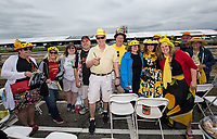 BALTIMORE, MD - MAY 20: Race fans pose for a photo against the rail before the start of racing on Preakness Stakes Day at Pimlico Race Course on May 20, 2017 in Baltimore, Maryland.(Photo by Douglas DeFelice/Eclipse Sportswire/Getty Images)