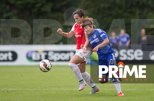 Marta Corredera of Arsenal Ladies and Ji So-yun of Chelsea Ladies battle for the ball during the Women's Continental Cup match between Chelsea Ladies and Arsenal Ladies at Wheatsheaf Park, Staines, England on 16 August 2015. Photo by Andy Rowland.