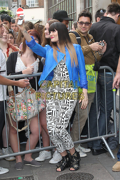 Jessie J (Jessica Ellen Cornish) at BBC Radio 1, London, England..May 31st, 2012.full length black white print jumpsuit blue blazer jacket open toe boots dyed hair blonde fringe bangs hair  fans crowd posing taking picture photograph profile.CAP/HIL.©John Hillcoat/Capital Pictures.