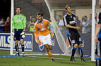 Chris Wondolowski (7) celebrates after scoring in the 34th minute ahead of Joe Cannon (left) and Kelly Gray (22). San Jose Earthquakes defeated Houston Dynamo 3-2 at Buck Shaw Stadium in Santa Clara, California on March 28th, 2009.