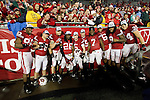 Wisconsin Badgers seniors pose for photographers after an NCAA Big Ten Conference college football game against the Penn State Nittany Lions on November 26, 2011 in Madison, Wisconsin. The Badgers won 45-7. (Photo by David Stluka)