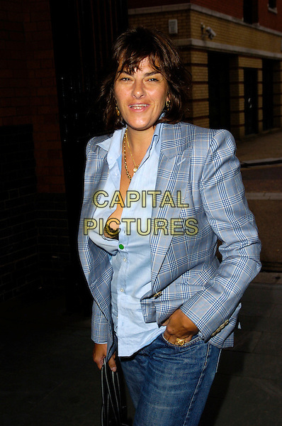 TRACY EMIN.The Mary McCartney Photography Exhibition private view, Oxo Tower Wharf, London, England..July 4th, 2007.half length tracey blue jacket shirt unbuttoned hand in pocket jeans denim bra black .CAP/CAN.©Can Nguyen/Capital Pictures