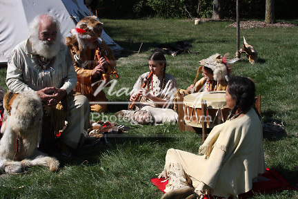 A Native American Indian family playing musical instruments