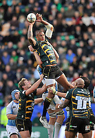 Northampton, England. Courtney Lawes of Northampton Saints wins a high ball during the Heineken Cup Pool 4 match between Northampton Saints and Glasgow Warriors at Franklin's Gardens on October 14, 2012 in Northampton, England.