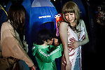 Tokyo, April 27 2013 - Yuichiro M. (32) trying a dress at the Propaganda party in Tokyo. Once a month, around 300 people gather to celebrate men dressed in girls. Josou (???can be married men who wish to have a new experience by dressing as women.