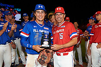 Raynel Delgado (3) of Calvary Christian Academy in Miami Lakes, Florida poses for a photo with Steve Bernhardt (15) after receiving the Kelly Kulina Award during the Under Armour All-American Game presented by Baseball Factory on July 29, 2017 at Wrigley Field in Chicago, Illinois.  (Mike Janes/Four Seam Images)