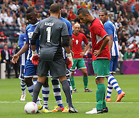 Men's Olympic Football match Honduras v Morocco on 26.7.12...Mohamed Amsif tries diversionary tactics to put Jerry Bengston of Honduras off at the penalty, during the Honduras v Morocco Men's Olympic Football match at Hampden Park, Glasgow...........